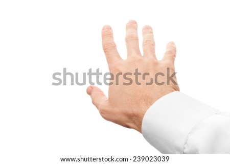 Business man hand trying to grab something, first-person view with selective focus isolated on white - stock photo