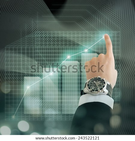 Business man hand with graphic - stock photo