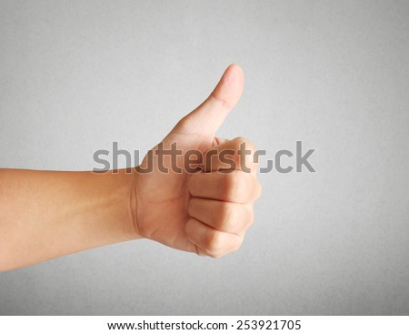 Business man hand with thumb up  - stock photo