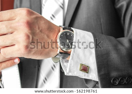 business man hand with wrist watch - stock photo