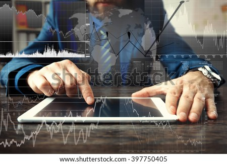business man hand working on laptop computer with digital layer business strategy and social media diagram on wooden desk