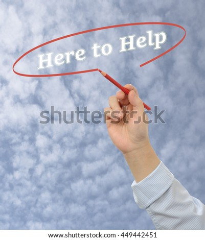 Business man hand writing here to help with white marker on blurred sky background - stock photo