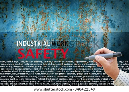 business man hand writing rules and keywords for industrial work safety concept for advertising and education - stock photo