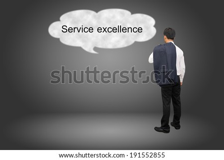 business man hand writing Service excellence - stock photo
