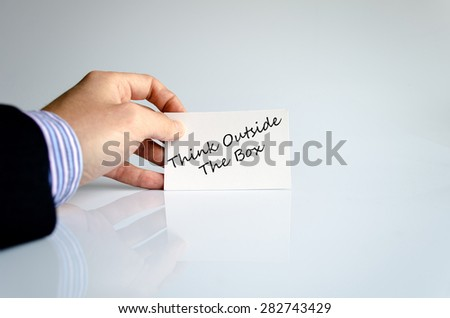 Business man hand writing Think outside the box - stock photo