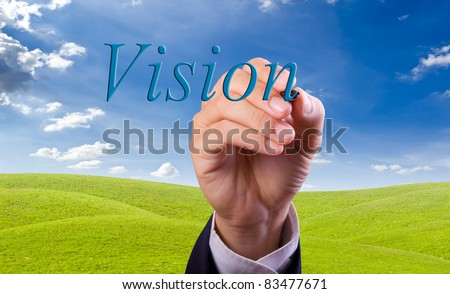 business man hand writing vision word - stock photo