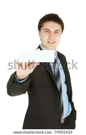 Business man handing a blank business card - stock photo