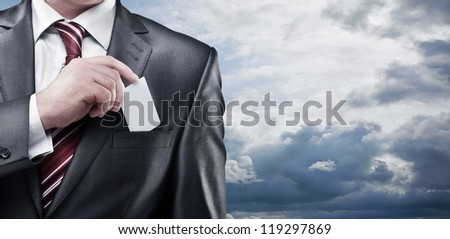 Business man handing a blank business card on the sky background - stock photo