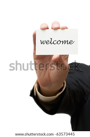 Business man handing a welcome business card over white background - stock photo