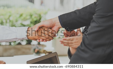 Business man handshake arriving for a job interview and greeting deal concept
