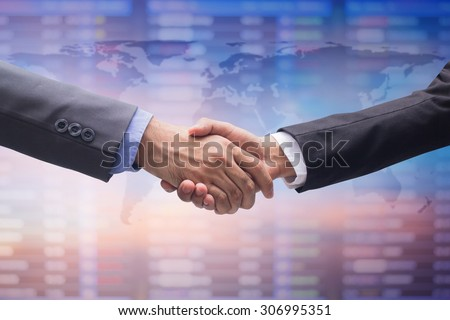 business man handshake over map on blurred business board, business hands concept. - stock photo