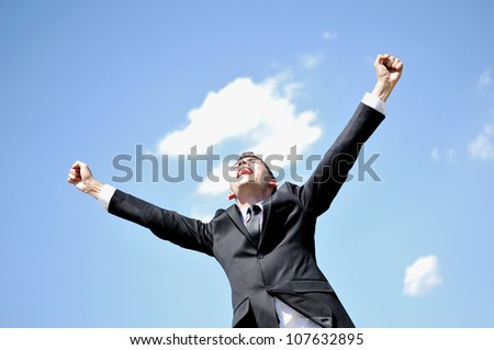 Business man happy on sky - stock photo