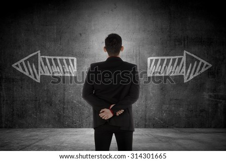 Business man has to choose between two way. Business option conceptual - stock photo