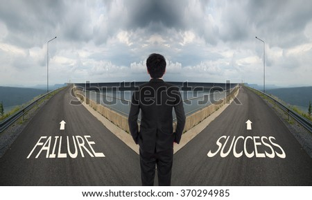 business man has to decide between two different way, choose Failure or Success road the correct way - stock photo