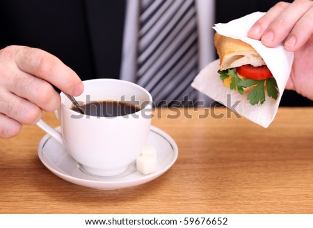 Business man having a breakfast - stock photo