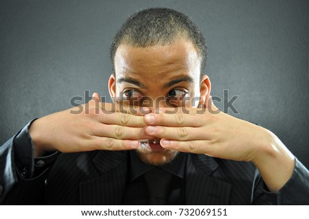 Business Man Hiding behind Hands