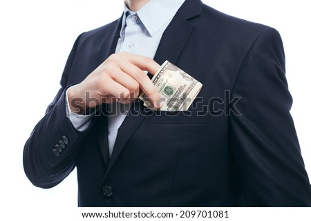 Business man hiding money in pocket on white background - stock photo