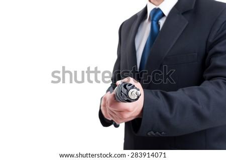 Business man, hitman or special secret agent holding umbrella like a riffle - stock photo