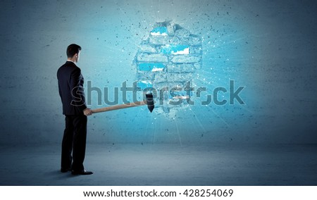 Business man hitting grungy brick wall with huge hammer - stock photo