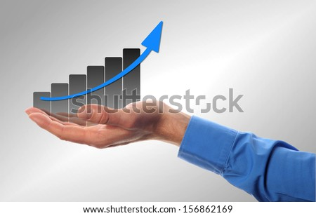 business man hold a chart with increasing beam  - stock photo