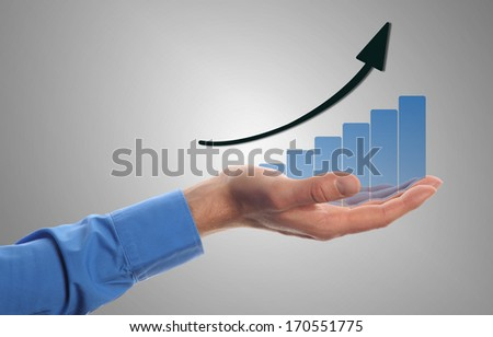 business man hold a chart with increasing beam