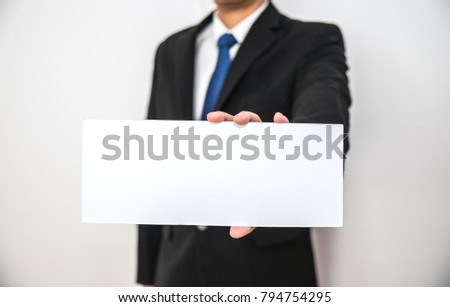 Business man hold blank white paper on hand with isolated white background