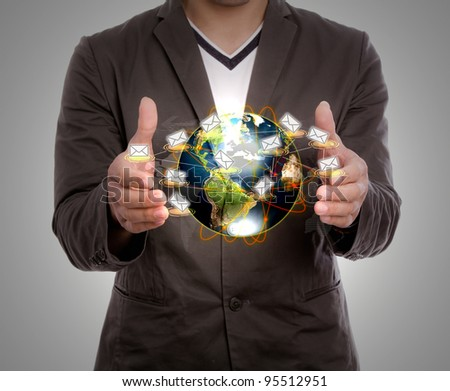 Business man hold earth of mail - stock photo