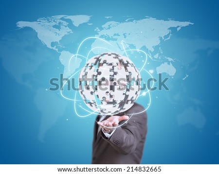 Business man hold exploding ball of gray puzzle pieces