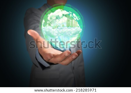 Business Man Hold Glass Ball with City and Cloud inside for use as Illustration - stock photo