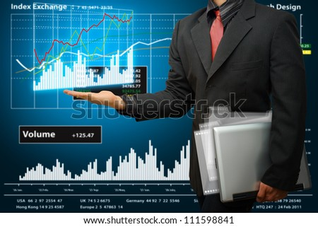 Business man hold laptop and graph report - stock photo