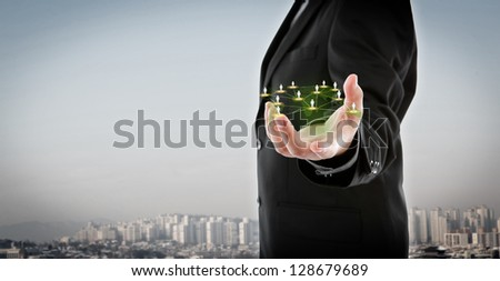 Business man hold social network - stock photo