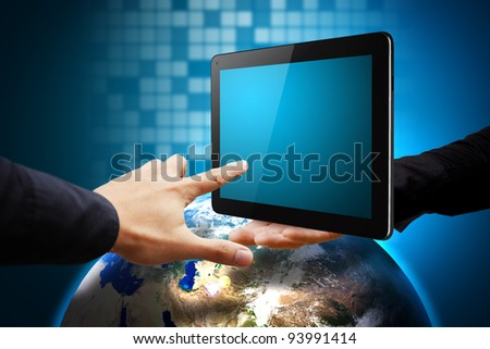 Business man hold tablet computer on globe and hand point - stock photo
