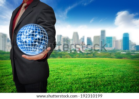 Business man hold the world - stock photo