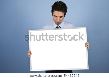 Business man holding a blank banner and looking down to copy space - stock photo