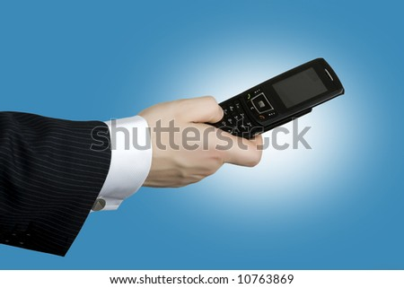 Business man holding a communication device - stock photo