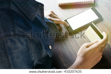 Business Man holding a credit  Work In Morning And Mobile Phone  (Vintage)