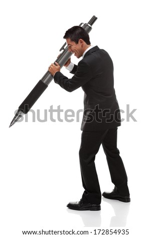 Business man holding a giant pen to the side looking down
