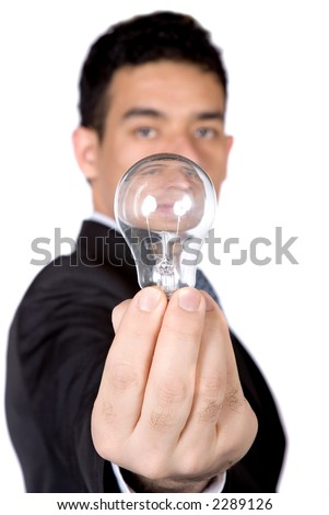 business man holding a lightbulb over white - narrow dof with focus on hand - stock photo