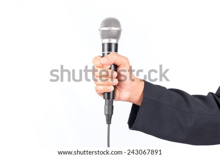 Business man holding a microphone isolated on white background