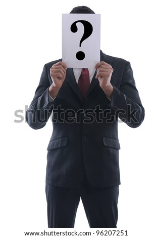 Business man holding a piece of paper over his face with a question mark on it isolated on white background in studio - stock photo