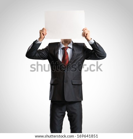 business man holding a poster, place for text