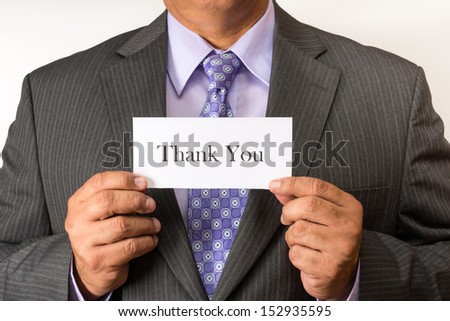 Business man holding a sign of thank you. Man thankful for having an office job.Worsening scenario for white collar workers as flatter structures are implemented in the new business concepts.