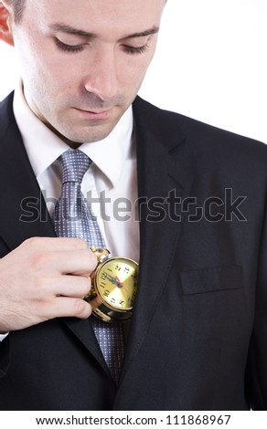 Business man holding a small clock