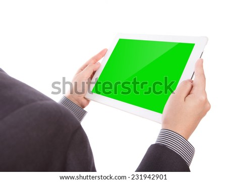Business man holding a  touch screen device  with green screen - stock photo