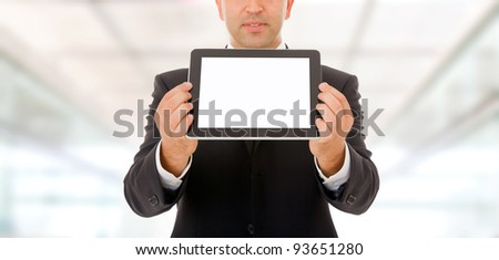 Business man holding and shows touch screen tablet pc with blank screen.