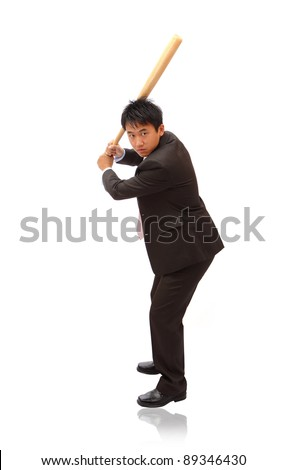 Business man holding bat ready for a hit - stock photo