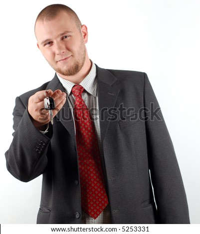 business man holding car key - stock photo