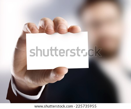 Business man holding card - stock photo