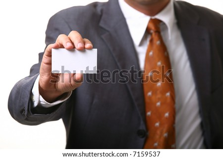 Business man holding card isolated on white