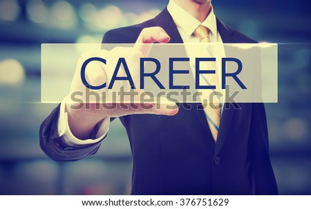 Business man holding Career on blurred abstract background